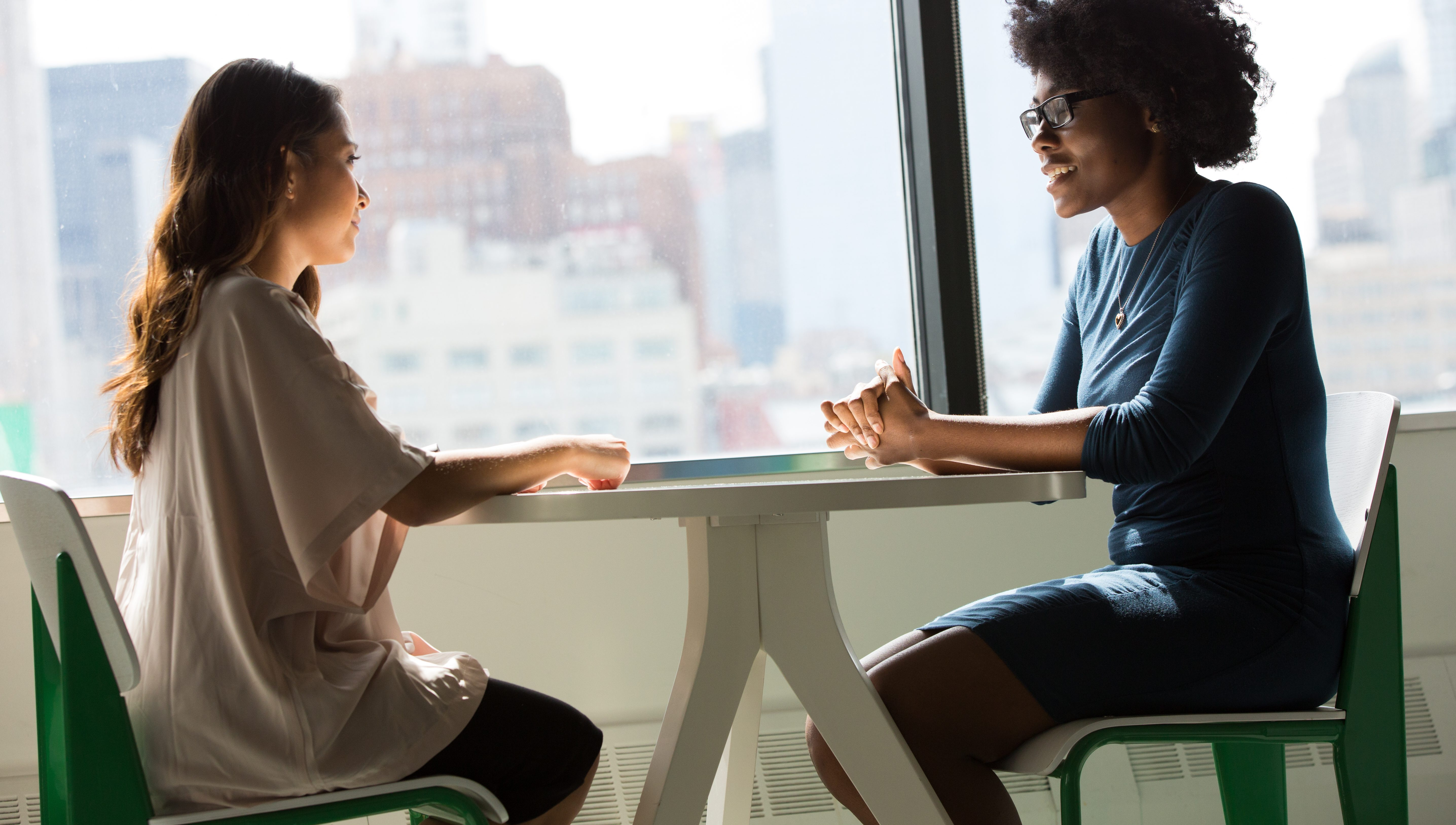 Two women sitting at a table talking