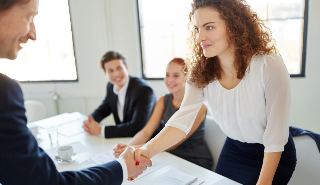 Woman shaking the hand of a new colleague