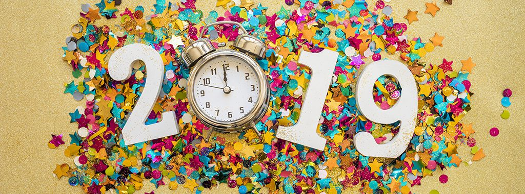 Image of 2019 with a clock and confetti. Celebrating a New Year.
