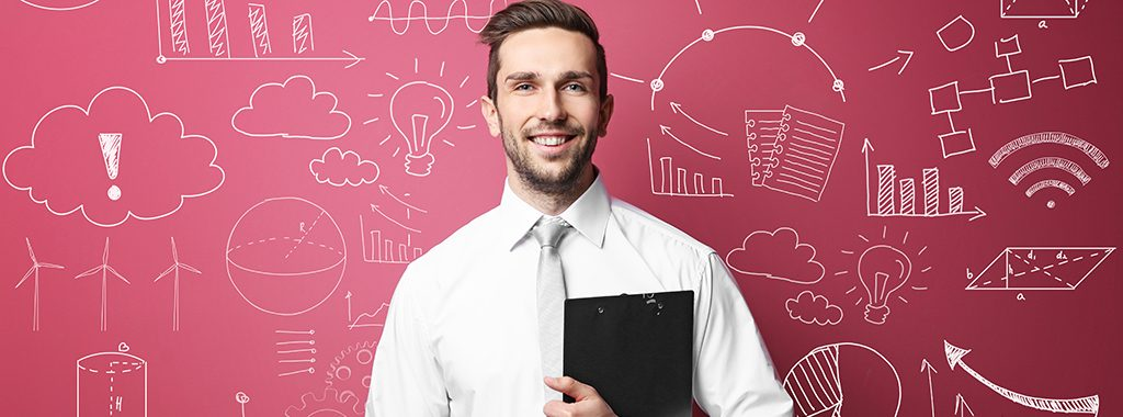 Smiling man standing in front of blackboard showing symbols related to science, math and business.