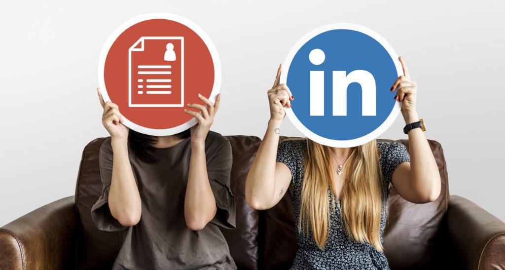 Interracial women holding icons representing Resumes VS LinkedIN
