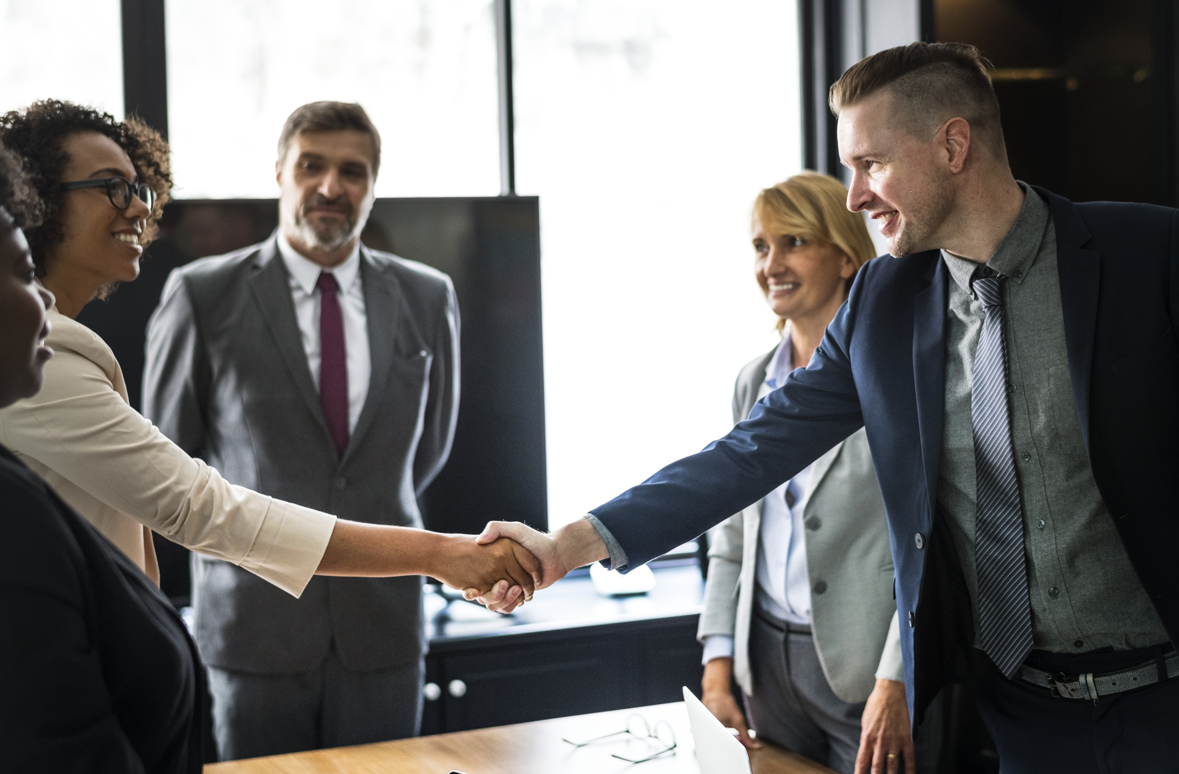 Business people shaking hands in a meeting room